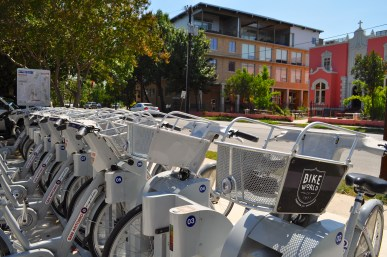 Plenty of bikes for rent just across South Alamo Street from the Liberty Bar, the pink former convent, and St. Benedict's Lofts. Photo by Iris Dimmick.