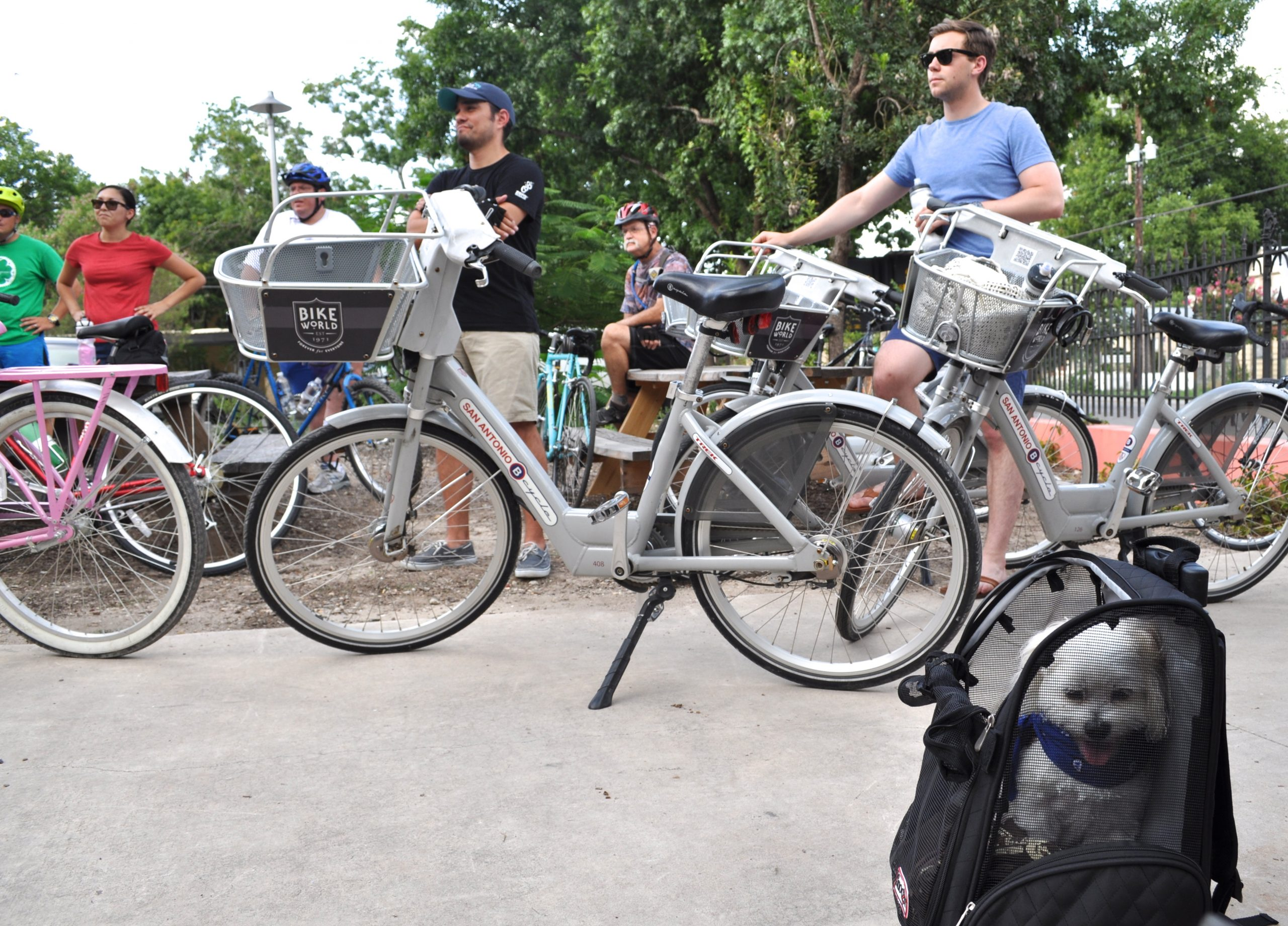 Sasha (right, backpack) listens to instructions with fellow riders for the first Something Monday ride. Photo by Iris Dimmick.