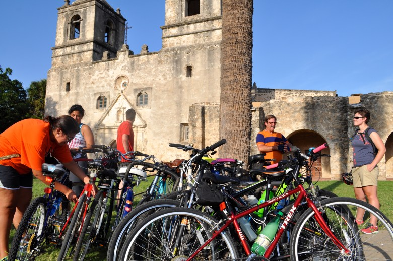 Something Monday riders lock up their bikes in front of Mission Concepción. Photo by Iris Dimmick.