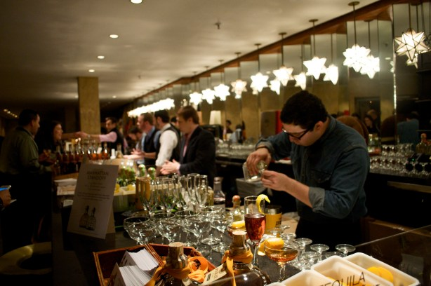 During the 2013 San Antonio Cocktail Conference, expert bartenders from Austin and SA share the long bar at the Majestic Theatre to mix and serve craft cocktails from sponsoring brands. Photo by Iris Dimmick.