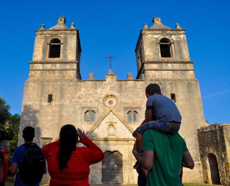 A family admires the recently restored Mission Concepcion during a recent Something Monday bike ride. Photo by Iris Dimmick.