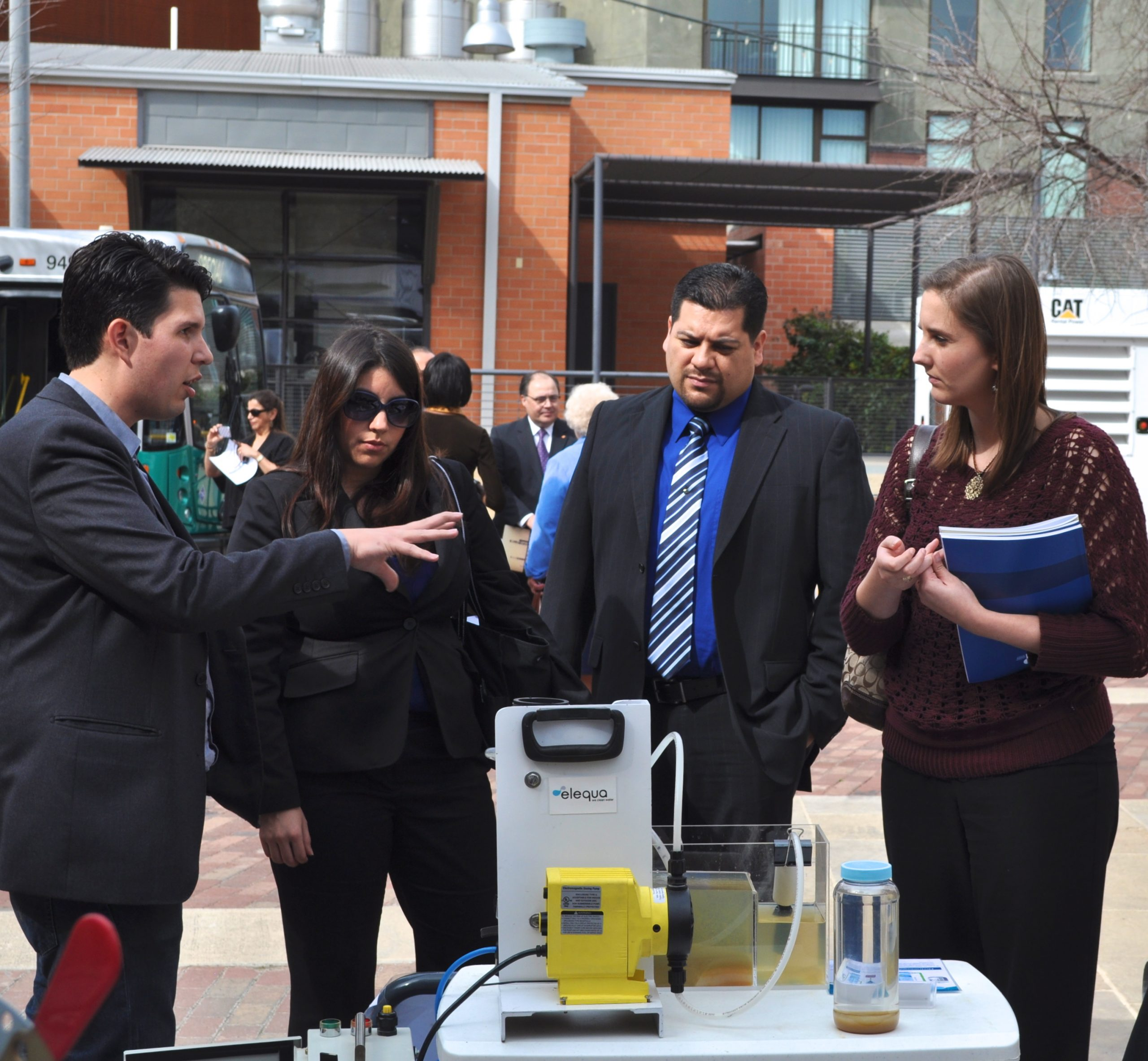 Ryan Beltrán explains how the Elequa technology works during a mobile demonstration. Photo by Iris Dimmick.