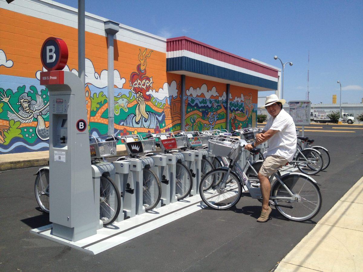 James Rodriguez at the Ace Mart B-cycle station in Southtown during his successful effort to complete Le Tour de B-cycle. Photo by Charlotte Luongo.