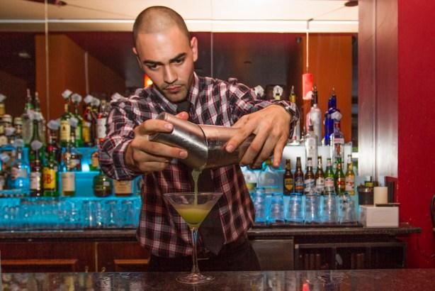 Richard Wilder pours a martini at Toscana Ristorante (formerly Le Midi), 301 E. Houston St. Photo by Steven Starnes.