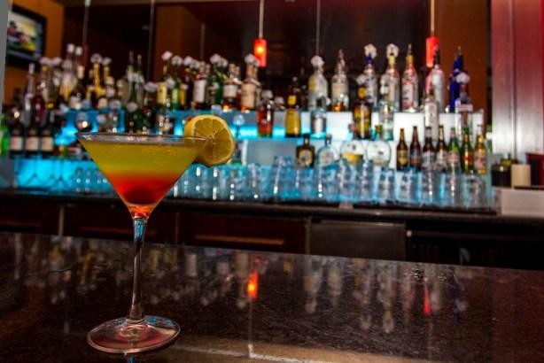 The Toscana Martini: midori, Bombay Sapphire, sour apple, cherry sync.