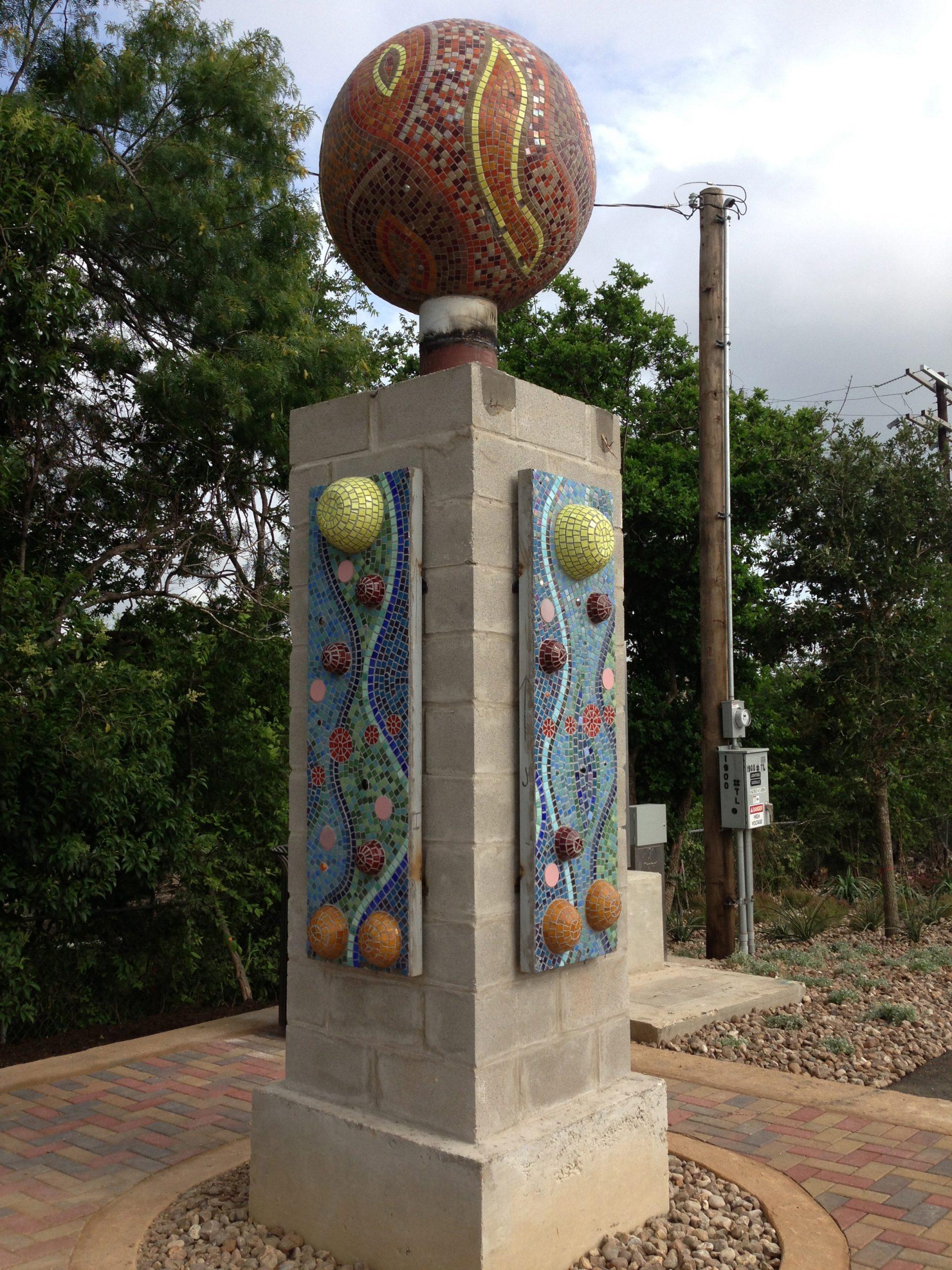 One of Oscar Alvarado's intricate columns that adorn Walters Street.