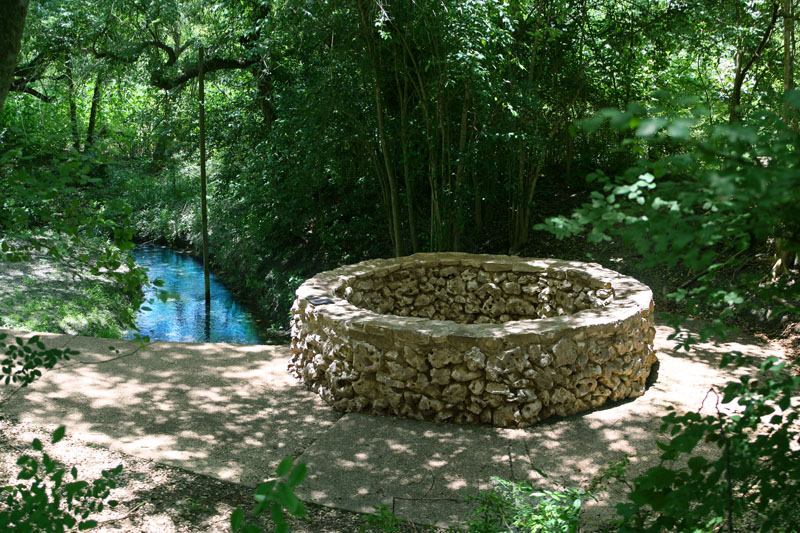 Water from The Blue Hole (above) issues from a large cavern and is now surrounded by an octagonal concrete and stone wall. Photo/caption courtesy of www.edwardsaquifer.net.