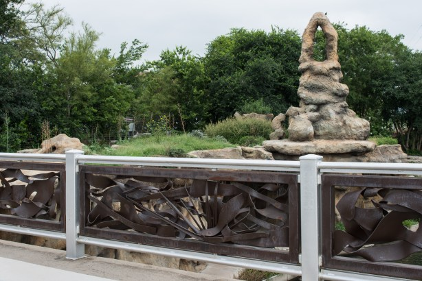 """Sculptor George Schroeder's """"River Origins And Movements"""" bridge installment overlooks Carlos Cortes' """"The Grotto"""" on the  Museum Reach. Photo courtesy of SARA."""