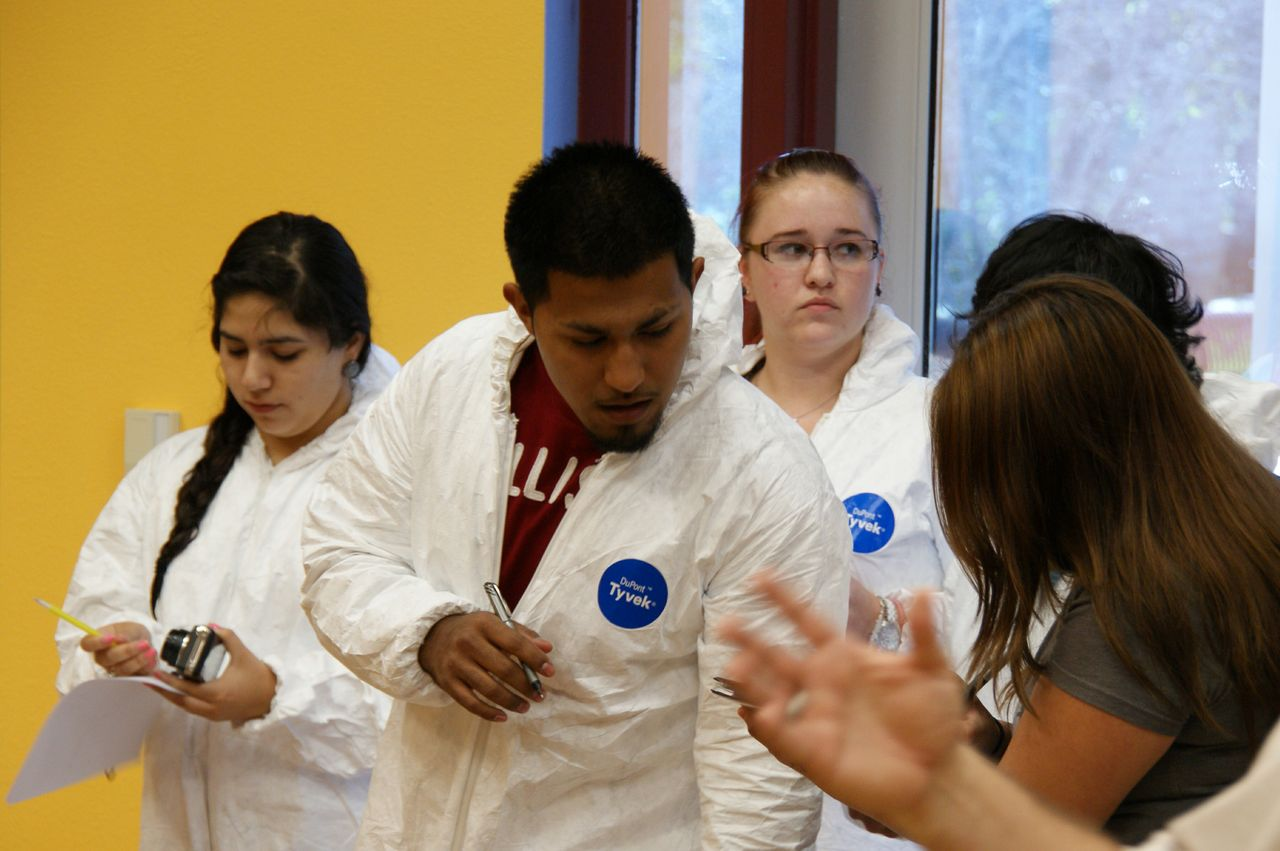 Students in Palo Alto College's Criminal Justice program learn through innovative learning methods in a simulated crime scene.