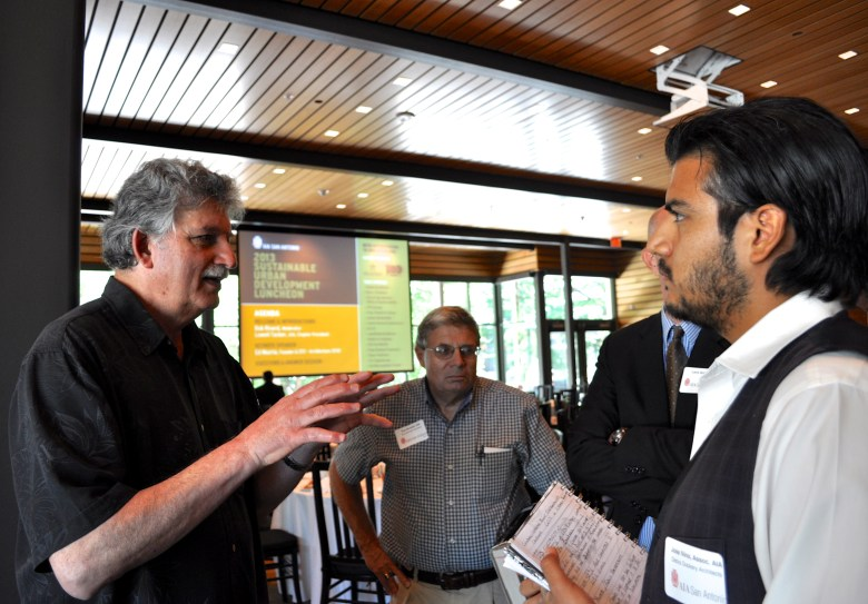 Edward Mazria talks to architects from several local firms after his presentation. Photo by Iris Dimmick.