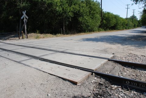 """The infamous """"ghost tracks."""" Allegedly, if you position your car on the tracks in neutral, a mysterious force will push it off. Some witnesses claim to find strange fingerprints on their trunks."""