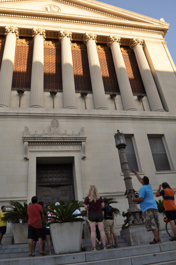Something Mondayers take photos and gaze up at the huge Scottish Rite Masonic temple on Avenue E. Photo by Iris Dimmick.
