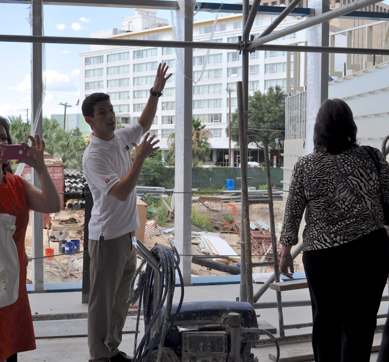 While leading a tour of the facilities, Anthony Wofford, co-founder of Convergent Theater, stands in the construction zone that will one day become the Tobin Center's black box theater. Photo by Iris Dimmick.