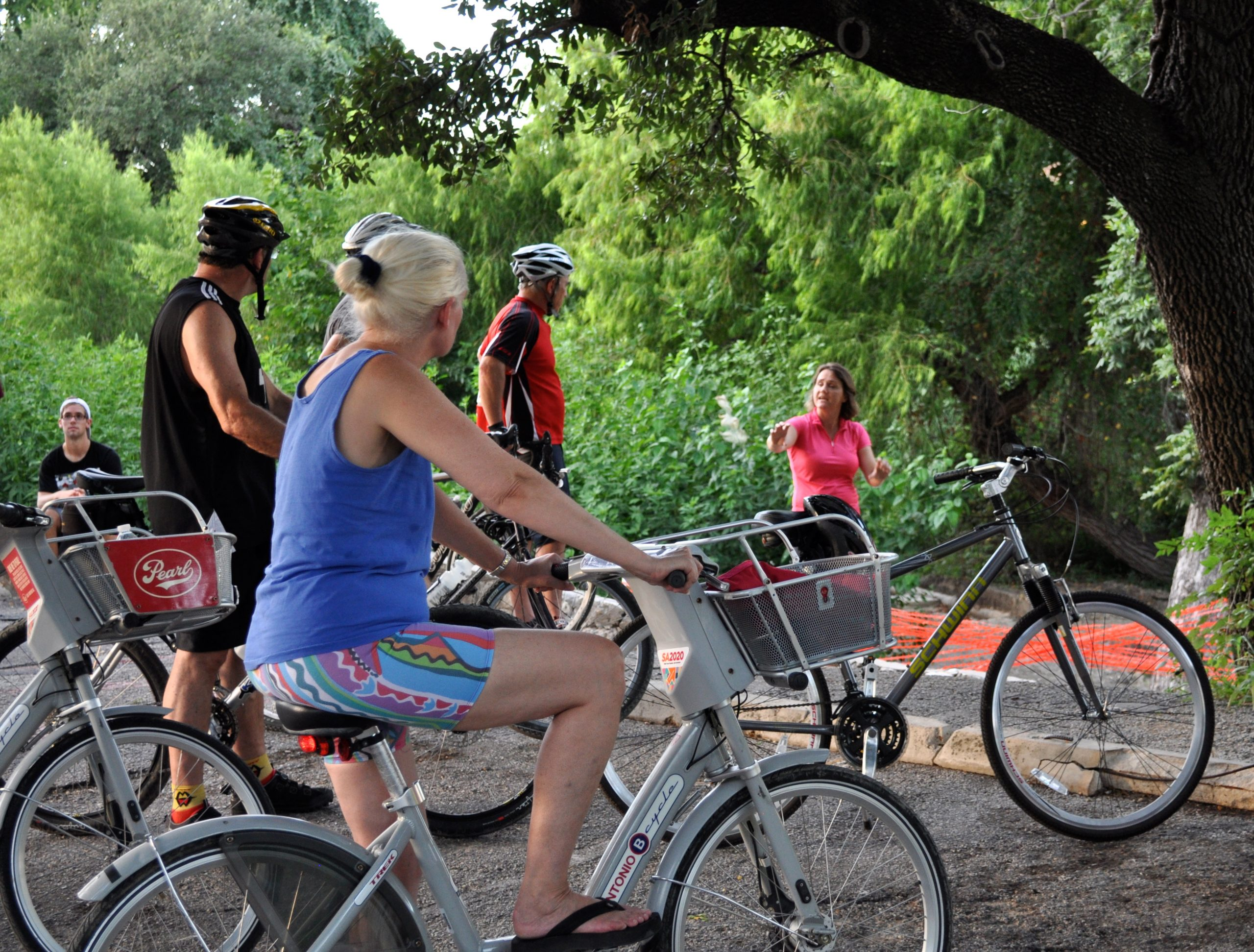 Something Mondayers on B-cycles and personal wheels listen to Powell describe San Antonio's historic acequias. Photo by Iris Dimmick.