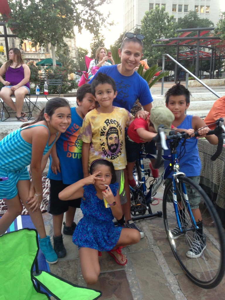 Kids of all ages enjoy an evening in Main Plaza during the new Cycle-In Cinema event. Photo courtesy of SATX Pedal Power / Edward Garcia.