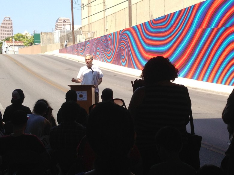 Congressman Lloyd Doggett speaks at the mural blessing in District 2.
