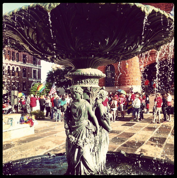 The Main Plaza fountain, a crowd of revelers gathered in celebration of the recent Supreme Court decision declaring DOMA and Prop 8 unconstitutional. Photo by Iris Dimmick (Instagram).