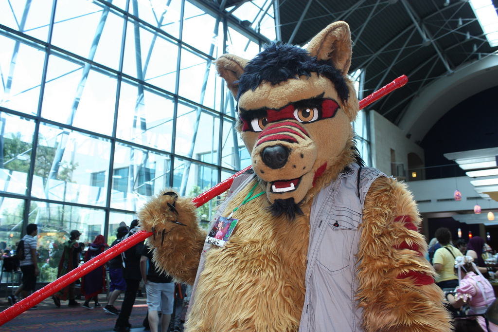 """""""Joe Wolf"""" poses for a photo after he and his friends finish snacking at the convention center. An increasing number of attendees braved the soaring temperatures to don their fur-based cosplay."""