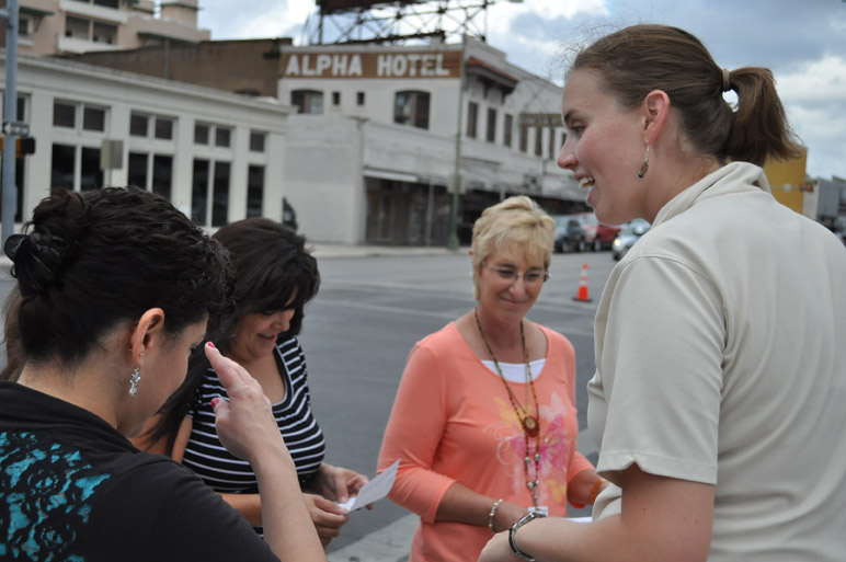 Meagan Wright, Special Projects Manager for the Center City Development Office, right, talks to visitors at PARK(ing) Day Sept. 27 in downtown San Antonio. (Photo by Annette Crawford)