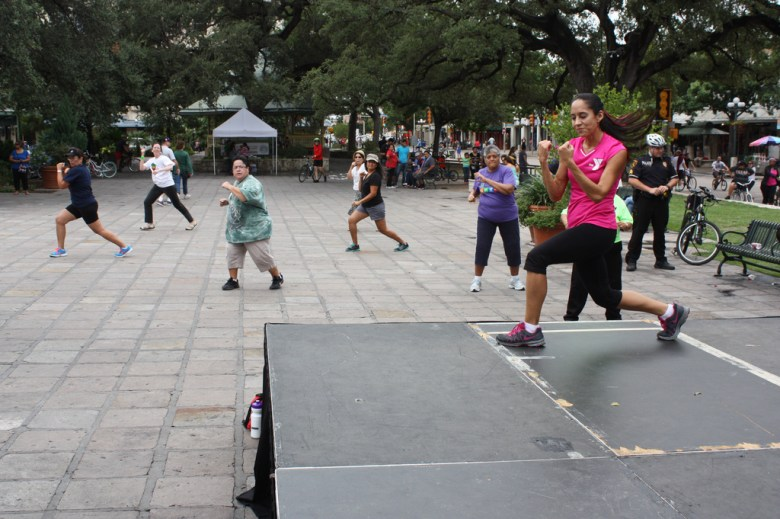 A flash workout mob begins in Alamo Plaza led by an instructor from the YMCA. Photo by Kay Richter.