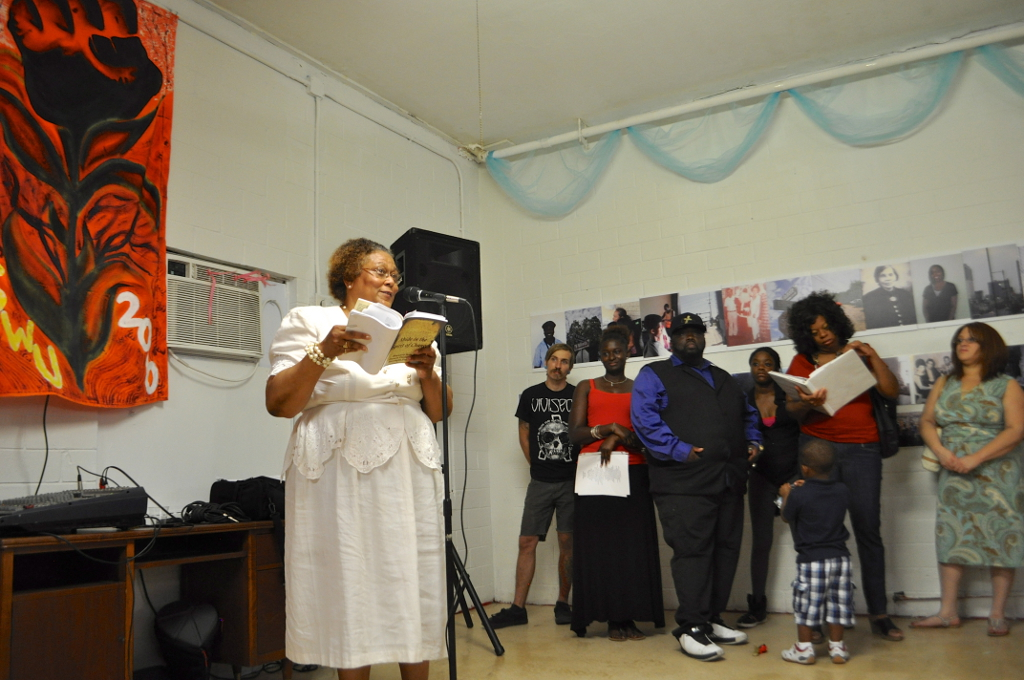 """Antoinette B. Franklin reads from a collection of her work for the the """"Eastside S.A."""" multi-media art installation at The Movement Gallery. Photo by Iris Dimmick."""