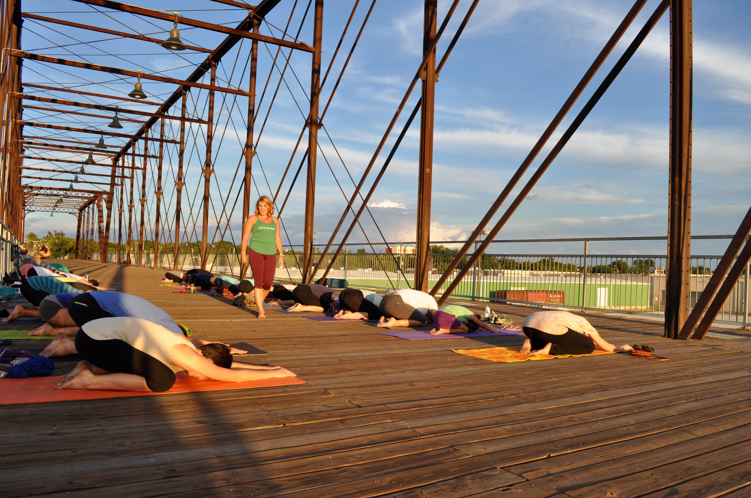 Cassandra Fauss guides yoga students during a recent session on the Hays Street Bridge. Photo by Iris Dimmick.