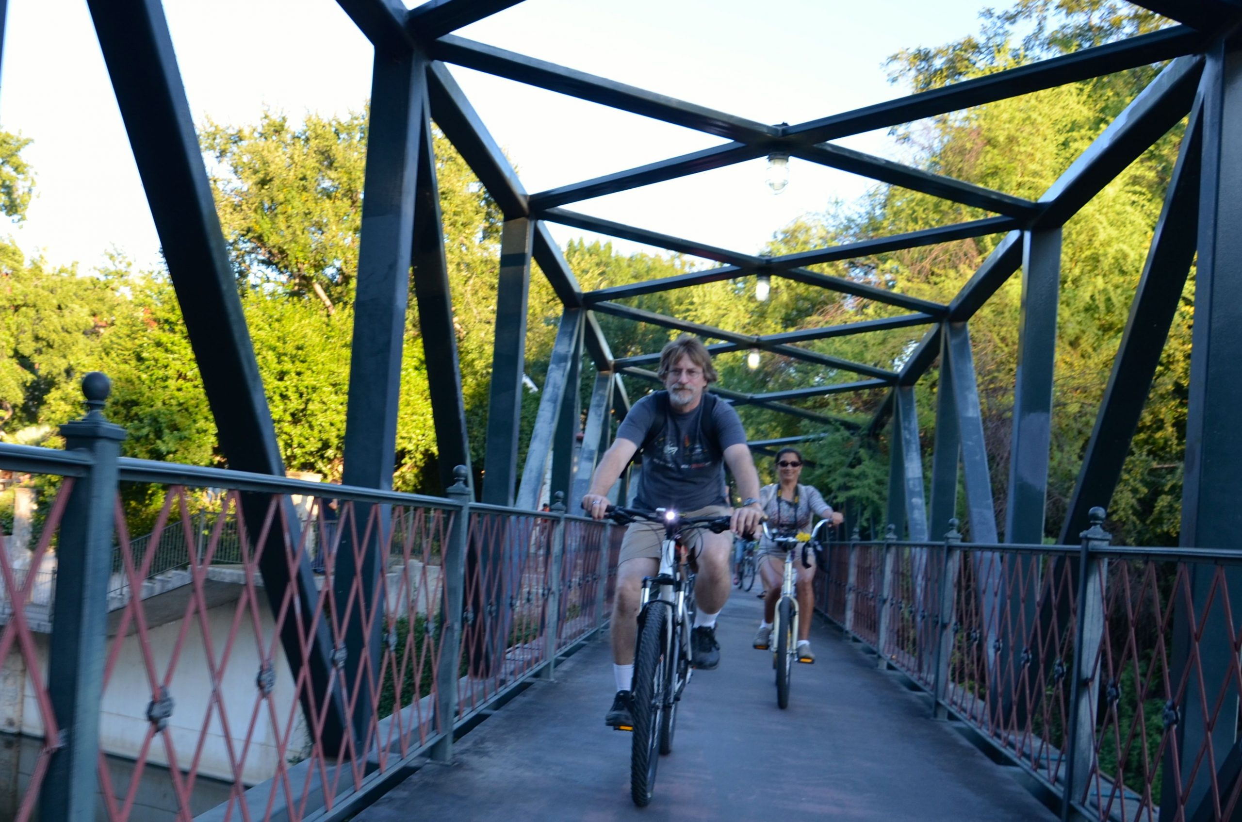 Something Monday rides over the San Antonio river via the Johnson Street footbridge. Photo by Steve Wood.