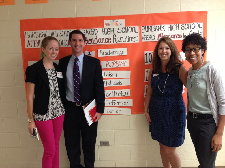 Hollis MacDonald of Spurs Sports & Entertainment, Scott Metzger of the 80/20 Foundation, Kimberlee Morrison of Communities in Schools, and Elizabeth Bonar Moseley of City Year stop to appreciate the Burbank High School Attendance Chart, part of a targeted effort by Diplomas Now. Photo by Bekah McNeel.