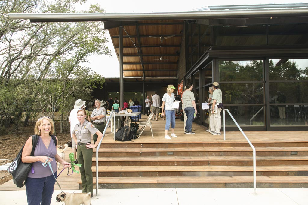 Visitors and guides mingle on the steps of Phil Hardberger Park's Urban Ecology Center. Photo Courtesy of Lake/Flato Architects.