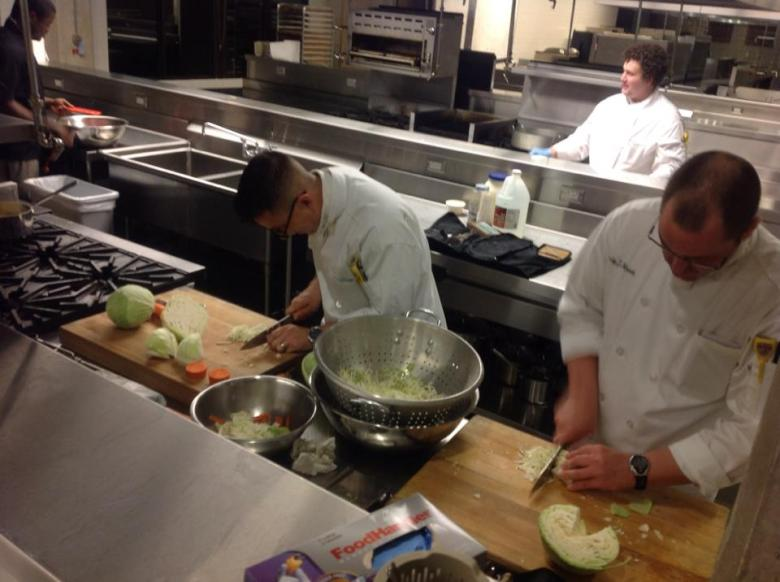 Jesse Torres and classmates prep food in the CIA kitchen.