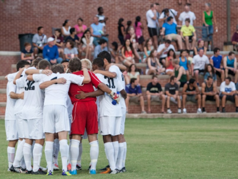 The Trinity Tigers in a pre-game huddle before their match against UT-Tyler in August 2013. Photo by Josh Moczygemba.