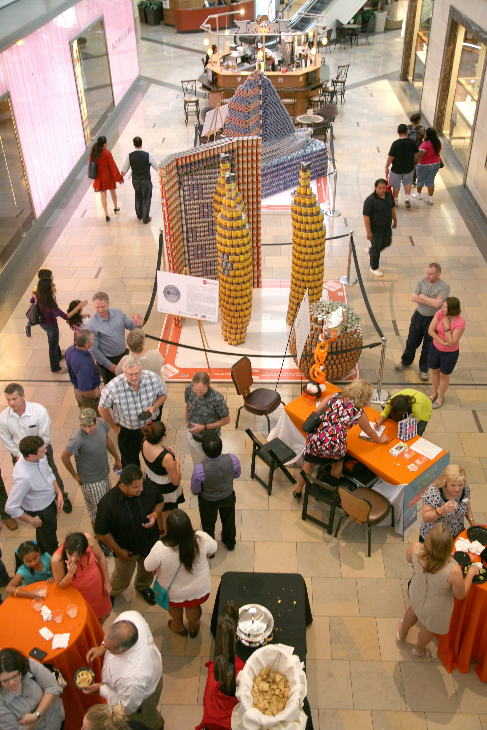 Architects, jurors, and casual observers curiously examine structures made of canned and processed food. Photo by Robert Hoang.