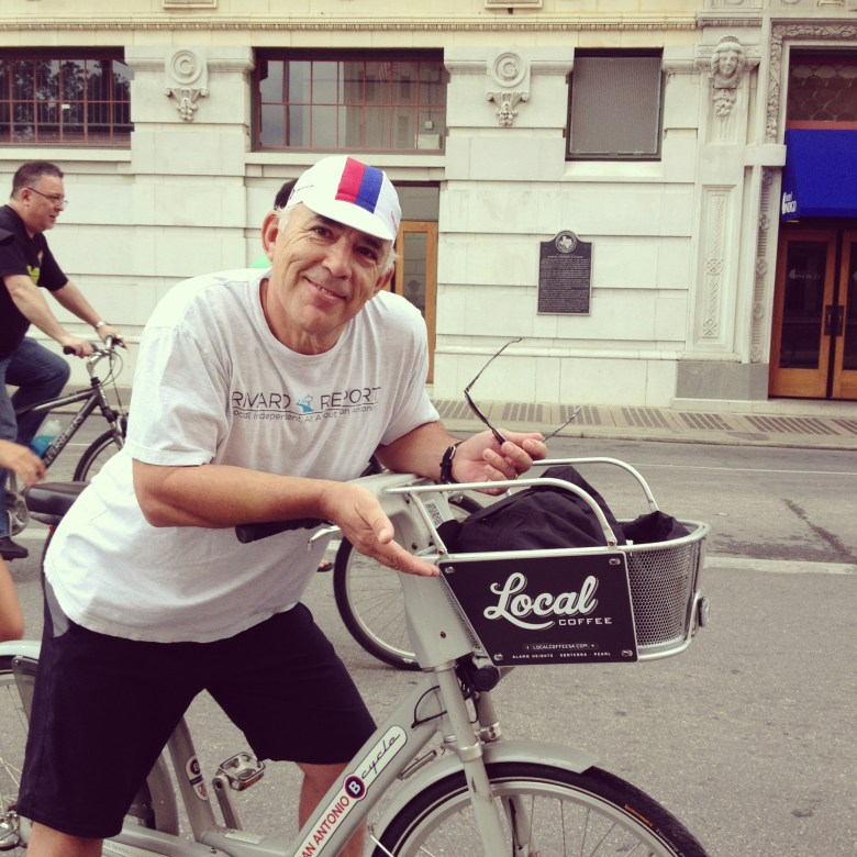 The author on a B-Cycle sporting a Local Coffee logo near the Alamo Plaza. Photo by Cindi Snell.