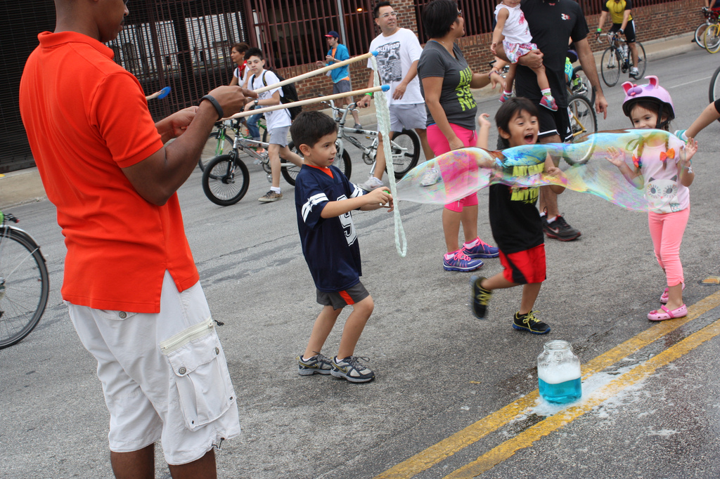 Bubbles, frisbee, jump-rope, parachute, sidewalk chalk – there's always more than bikes at Síclovía. Photo by Kay Richter.