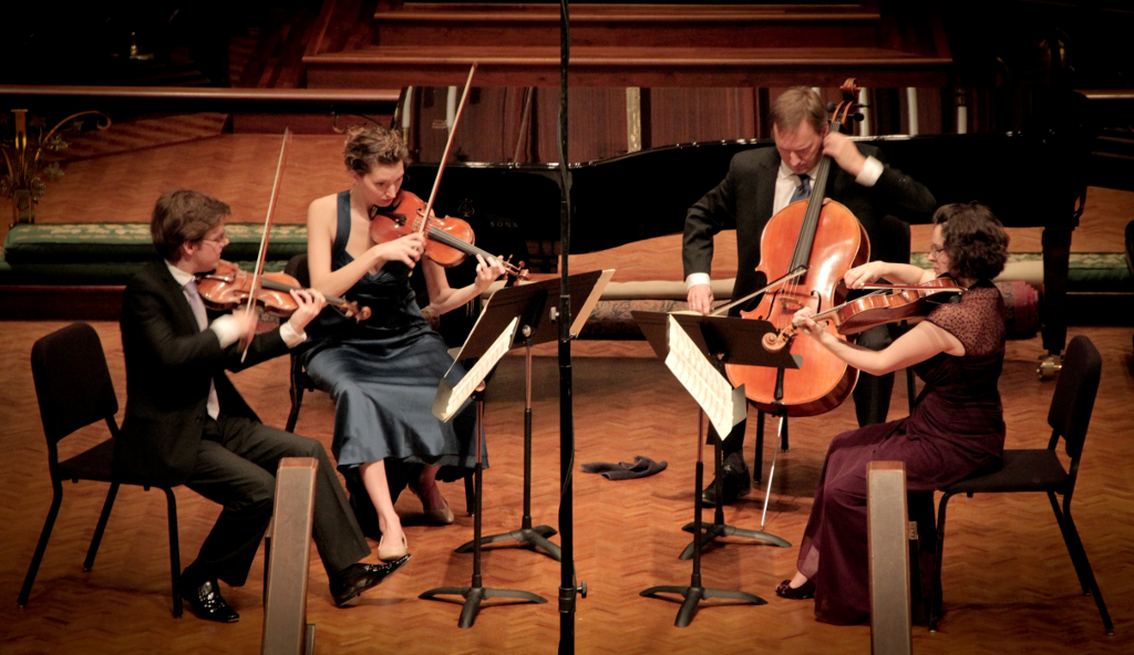 Matthew Zerweck, Anastasia Storer, Ken Freudigman, Emily Freudigman perform at Christ Espiscopal Church for the 2013 Brahms Festival. Courtesy of Camerata.