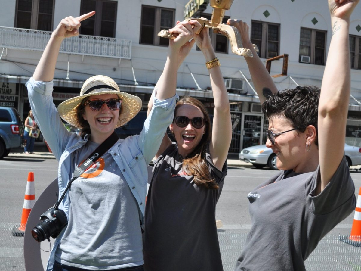 Molly Cox, right, and members of her team celebrate SA2020's first place win at PARK(ing) Day Sept. 27. Photo by Annette Crawford.