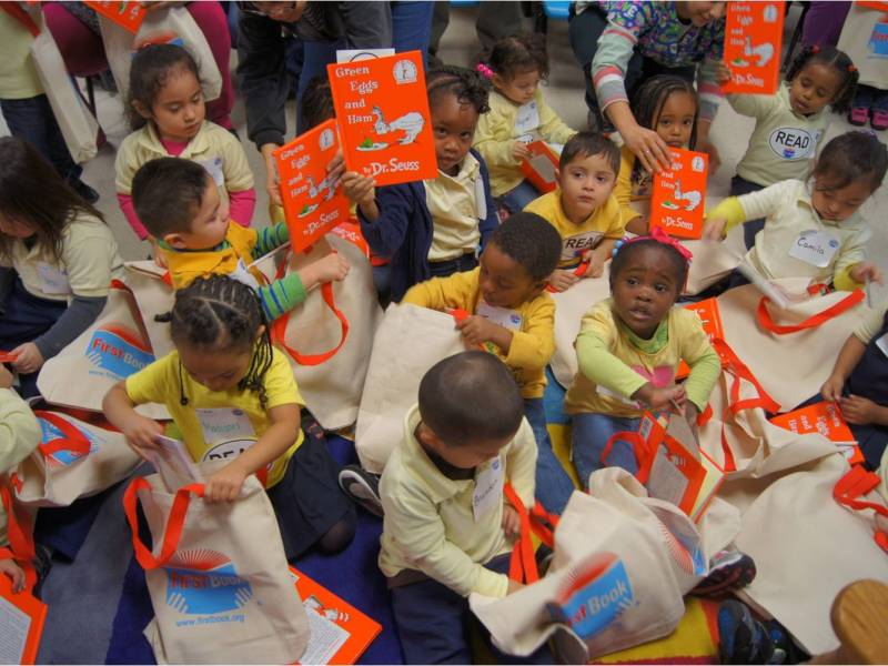 Children eagerly receive their first copies of Green Eggs and Ham. Photo courtesy of First Book