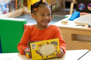 Many of the children served by First Book have never owned a book of their own before. Photo by McGrath Photo, courtesy of First Book.