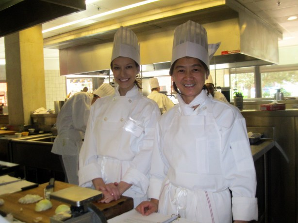 Me with my teammate Molly taking a break from onion chopping