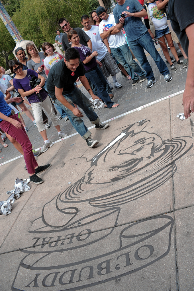 Featured artist creating a chalk masterpiece. Photo by Chris Saucedo.