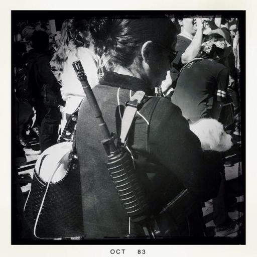 An armed participant listens to speakers at the gun rally in Alamo Plaza. Photo by Leslie Kelly.