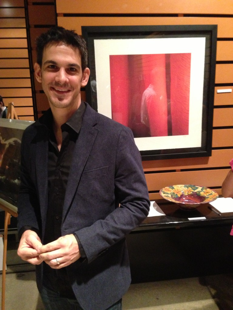 "Scott Martin with his piece ""Red"" at the St. Paul's Fall Fete. Martin is a St. Paul's Montessori School Parent"