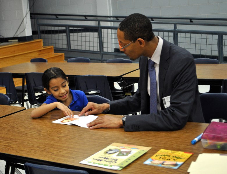Diamond and Darryl Byrd work through words and pictures during their SAYL reading buddy session. Photo by Iris Dimmick.