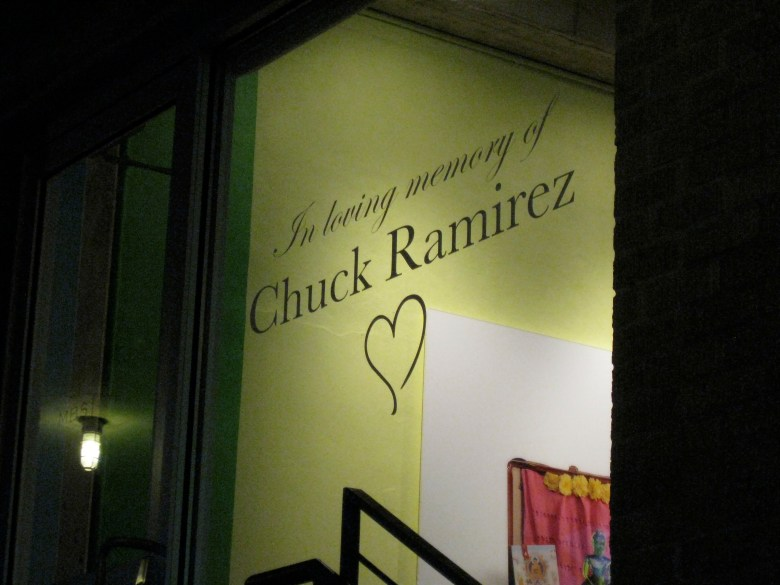 A tribute in the door of the retail space he helped design.