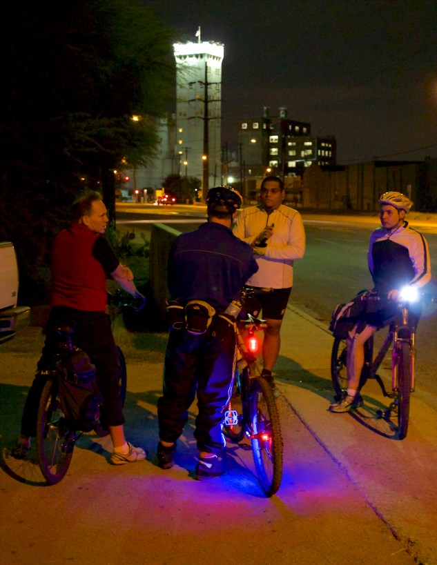 Cyclists take a break during their ride through downtown.