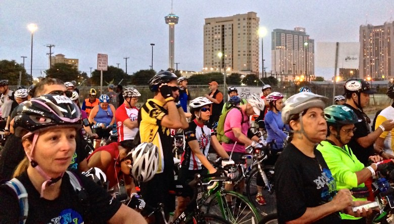 The iconic Tower of the Americas sits in the background as the sun rises and riders prepare to hit the bike course.