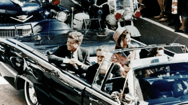 US President John F. Kennedy in a limousine in Dallas, Texas, on Main Street, minutes before the assassination, 22 November 1963. Image by Walt Cisco, Dallas Morning News/Wikipedia/Public Domain