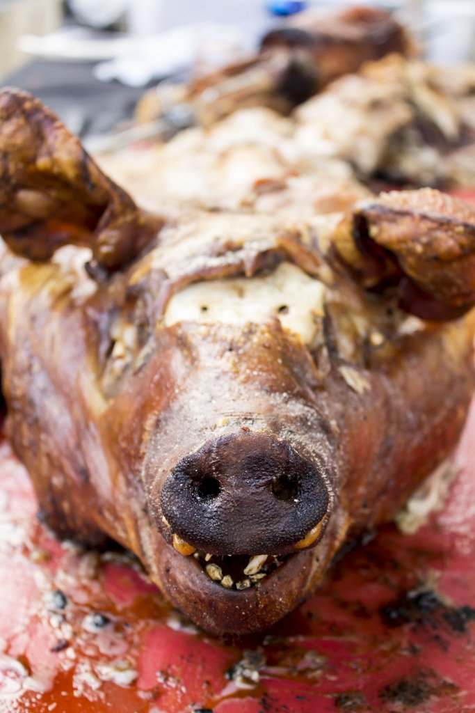 Nelson Millan of the San Antonio Country Club's lechon and trunchetta--a whole, boned roasted Duroc hog cooked in La Caja China double-decker grill boxes, accompanied with mojo picked onions. Photo by Jesse Torres.