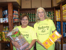 Patti Radle (right), Inner City Development Co-Executive Director and SA2020 Board Member, with another volunteer in the Food Pantry. Courtesy photo.