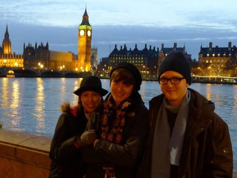 My mom, brother and I pose in the freezing cold for touristy photos in London. Note my crossed arms, protecting me from the rain and sleet. Photo by Brett Calvert.